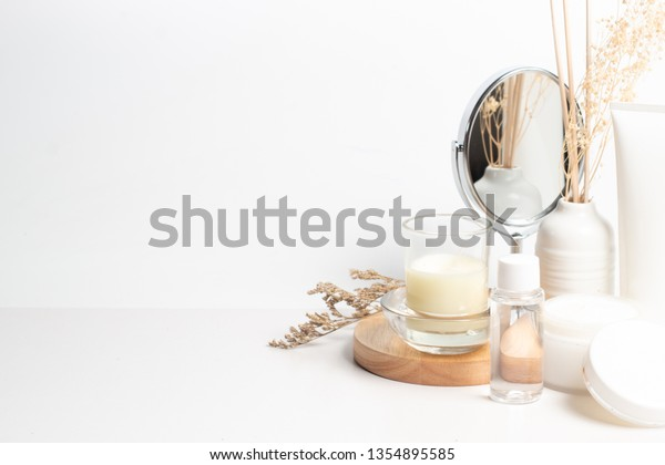 mirror and beauty fashion spa treatment lotion cream spf aromatic cosmetic perfume with background, mockup product package, herbal leaf flower, candle, wood palte, body spray, vintage style
