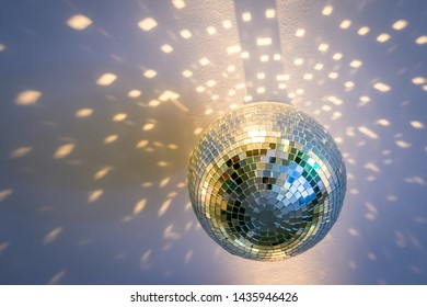 a mirror disco ball on the ceiling that sparkles around beautiful glare