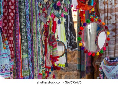 Mirror, handkerchiefs, scarves and handmade fabrics and beautiful bright colors, sold in a hippy market of Ibiza, Balearic Islands, Spain.