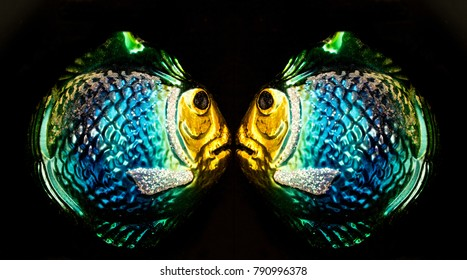 Mirror Image of Two Shiny Glass Fish Christmas Ornaments