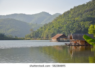 Mirror lake with Bamboo hut raft float on the lake with mountain,Khao Wong  reservoir,  Suphanburi  , Central of Thailand