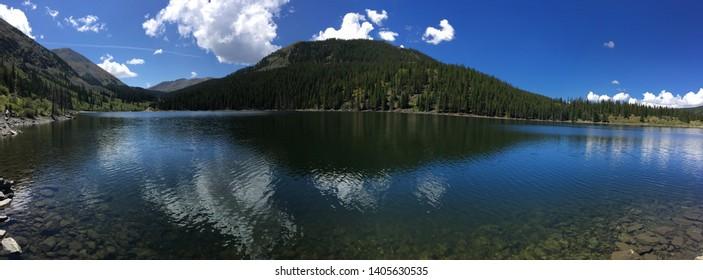 Mirror Lake, Colorado. Glass like lake resting above Taylor Reservoir.