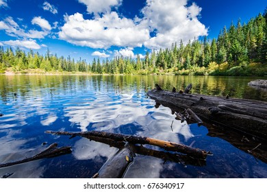 Mirror Lake at High Elevation in Oregon with smooth water on the shore