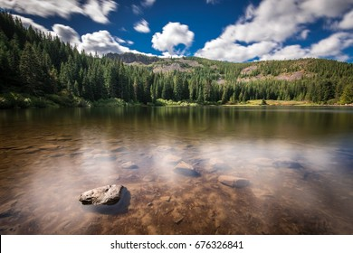 Mirror Lake in Oregon on a Blue Sky day with Clouds reflected in the water