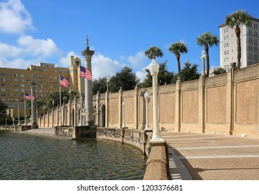 """Mirror Lake Park, the crown jewel of downtown Lakeland, Florida.  With ornamental lamp posts and Corinthian columns the promenade became part of the """"City Beautiful"""" movement in the 1920s."""
