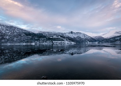 Mirror like reflection in lake mountains winter