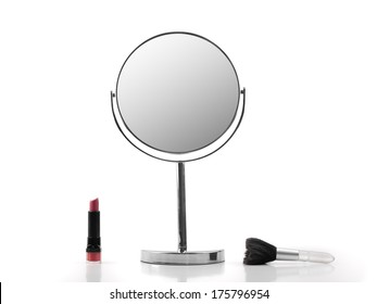 Mirror, Lipstick and brush over white background, for fashion and beauty themes