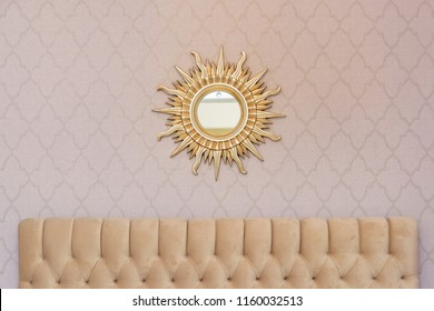Mirror on the wall. Mirror in the form of the sun. Creative baguette for a mirror