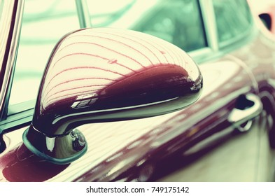 Mirror of the original cherry-old car. Vintage style. Sophistication.