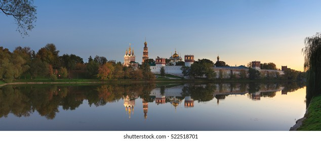 Mirror reflections in pond near Novodevichy Convent, Moscow, Russia