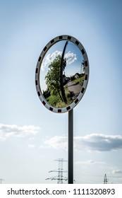 mirror road sign