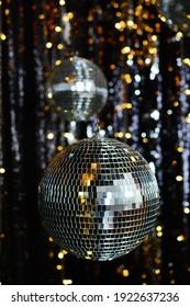 Mirror shiny balls in a dark room