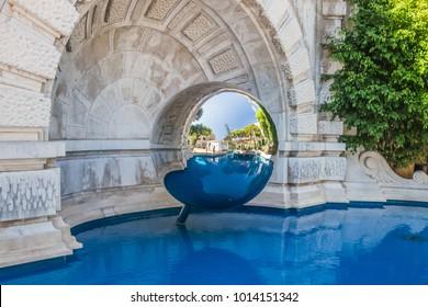 Mirror sphere and a pool in the garden near Monte Carlo Casino, Monaco