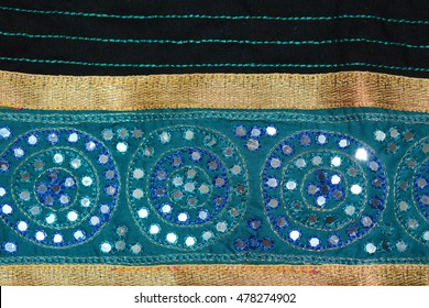 Mirror studded sari with embroidery design