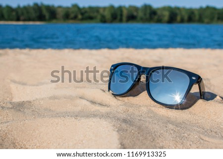 91fcdc72ee94 Mirror Sunglasses On Sand Beach Stock Photo (Edit Now) 1169913325 ...