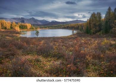 Mirror Surface Lake Breathtaking Autumn Landscape With Mountain Range On Background