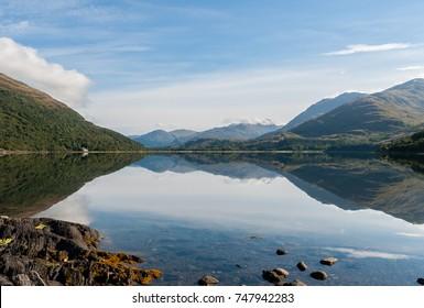Mirror view - Reflections of mountains in Loch Creran - West coast Highlands, Scotland, UK