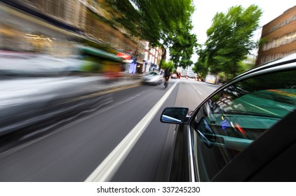 Mirror view of speeding car.