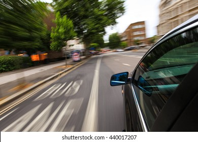 Mirror view of speeding car.