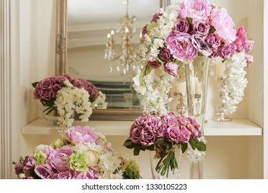 mirror, white and purple flowers in glass vases