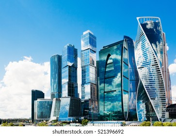 Mirrored skyscrapers business center Moscow-City on a background of blue sky