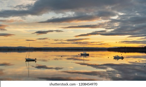Mirrored sunset on Findhorn Bay, Moray, Scotland