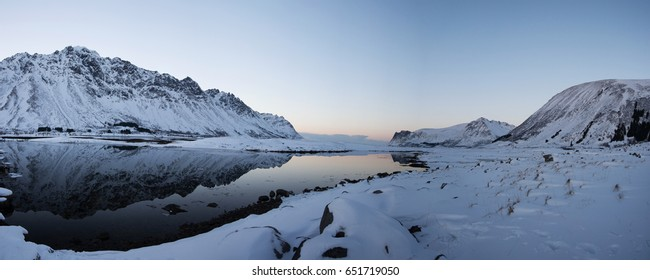 Mirroring in a lake at Knutstad at the Lofoeten, Norway, in winter time evening.