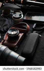 mirrorless camera and hobby stuff in dark background