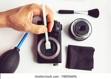 Mirrorless Sensor cleaning and Maintenance,Photographer hand cleaning sensor of camera by using sensor swab and vacuum pump,cleaning dirty camera sensor CCD or Cmos