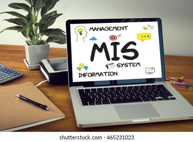 MIS  Management Information System  Data Development Information and MIS Laptop on table. Warm tone