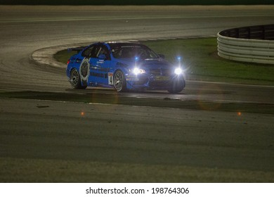MISANO ADRIATICO, Rimini, ITALY - May 10:  A BMW M3 GT4 PRO of Las Moras Racing Team, driven By SEVERS Rob and  BRAAMS Liesette (NED) , the GT4 European Series car racing on May 10, 2014