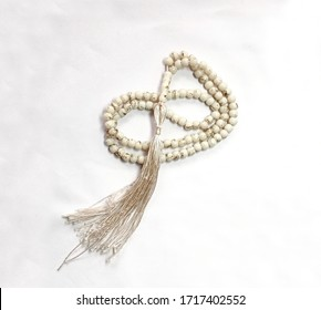 A misbaḥah or misbaha, tespih or beads for keeping count of muslim prayers, Islamic Muslim Prayer Beads isolated on white background