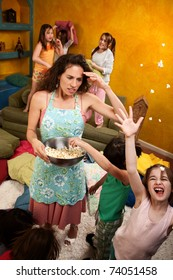 Misbehaving kids throwing popcorn with an unhappy babysitter