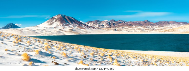 """Miscanti Lagoon and """"Miscanti hill in the Altiplano (High Andean Plateau) at an altitude of 4350m, Los Flamencos National Reserve, Atacama desert, Antofagasta Region, Chile"""