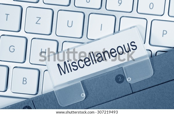 Miscellaneous - folder with text on computer keyboard in the office