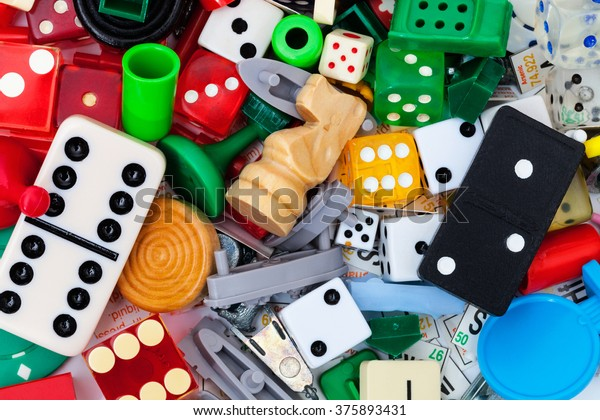 Miscellaneous old board game pieces