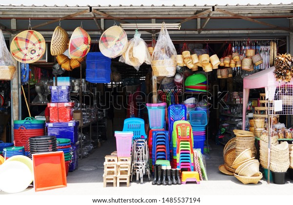 Miscellaneous street shop. Traditional of store front of miscellaneous shop that selling cooking stuff, cleaning tools, plastic chairs and household items for street food hawkers and houses. Thailand.