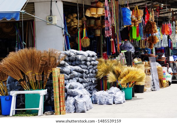 Miscellaneous street shop. Traditional of store front of miscellaneous shop that selling charcoal bags, kitchen stuff, cleaning tools, and household items for street cart hawkers and houses. Thailand.
