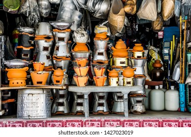 Miscellaneous street shop.Traditional local store front of charcoal burning stove, sell to street cart hawkers. Terracotta stove for grilling, frying, stirring and boiling. Thailand, Asia.