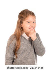 Mischievous little girl devising a plan dressed in school uniform