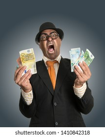 Miserly businessman counting his money