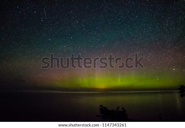 Misery bay, Michigan / United States - July 24, 2017:  Surprise Northern Lights event while camping in the Misery Bay in the Upper Peninsula of Michigan on July 24, 2017.