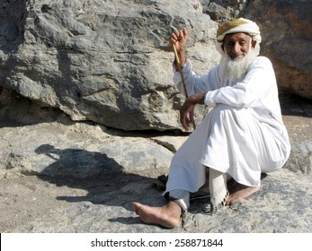 MISFA, OMAN - DEC 29 2007:An old Omani man wearing dishdash in Al Abreyeen village Misfah, Oman.It's an insight of how the locals used to live centuries ago.