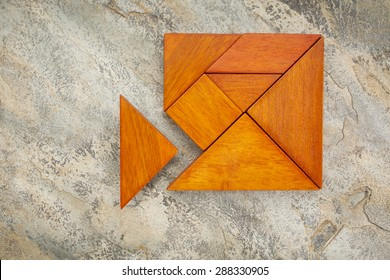 misfit concept - triangular piece is too large to fit into tangram square puzzle