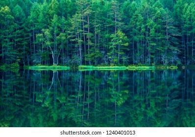 Mishaka pond (Mishakaike)in Japanese blue and  green lake. Chino City, Nagano Prefecture, Japan