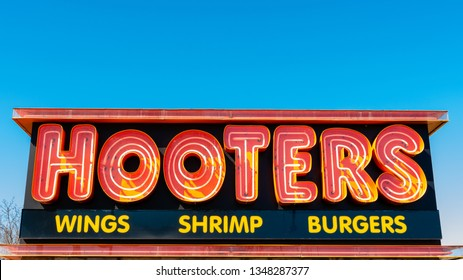 Mishawaka, Indiana, United States, March 23, 2019, Hooters is a restaurant that sells hot wings and burgers and is know for their waitress that wear orange shorts and a white Hooters shirt.