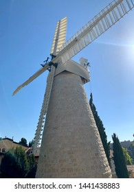 Mishkenot Sha'ananim neighborhood, Jerusalem, Israel. Beautiful historical area in the old town of Jerusalem. Large wind mill, view from the side. Montefiore windmill.