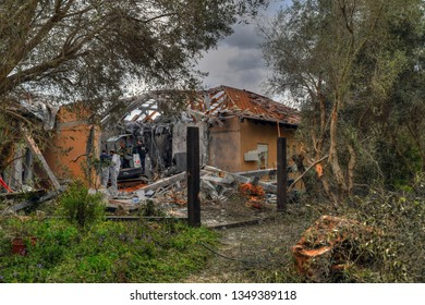 MISHMERET, KEFAR SABA, ISRAEL, MARCH 25, 2019: Search and rescue tram a ruined Israeli house a short time after a missile launched by Hamas from Gaza during the Israeli-Palestinian Conflict, 2019