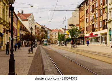 MISKOLC - APRIL 15: Main street of the city with tram rails and walking people on April 15, 2017 in Miskolc, Hungary.