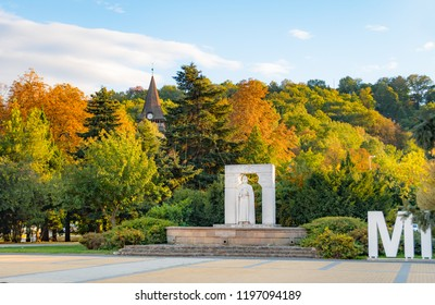 Miskolc city center with the statue of Saint Stephen and Avas Church on top of Avas Hill in autumn colors